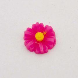 Zwevende bedel bloem fel roze