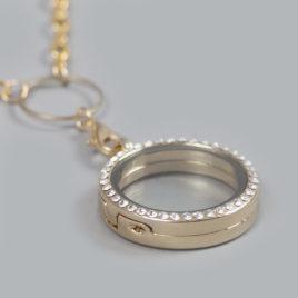 Glazen medaillon rond met steentjes goud